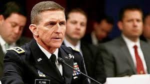 Generolas - leitenantas Maiklas Flintas, kuris dažniausiai prisimenamas kaip tas Amerikos karininkas, kuris pietavo prie vieno stalo kartu su Rusijos prezidentu Vladimiru Putinu.